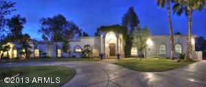 Welcome to this stunning Santa Barbara style home in Paradise Valley.