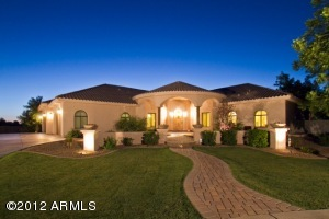 Great curb appeal in this quality custom home tucked in a private setting in a quiet cul-de-sac