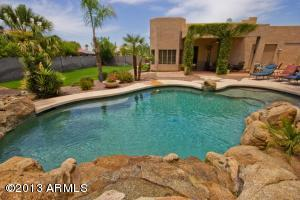Fabulous custom built pool with professional landscaping