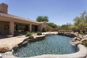 This home is located on a 1.17 acre lot. The backyard is spacious with pebbletec pool with water feature and spa.