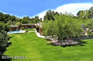 A Private Oasis: Rolling Lawn & Stately Desert Trees.