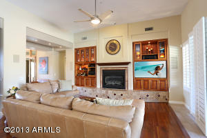 Wood floor, custom cabinets and gas fire place