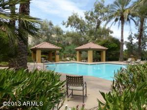 Lush grounds surround the community pool