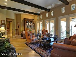 Hard wood floors, beamed ceilings, French doors to patio