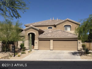 This beautiful Shea built home was repainted in 2009. It is nestled in a gated community of McDowell Mountain. Neighbors surrounding this home are quiet. New desert landscaping. North/South exposure.