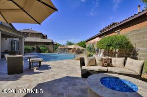 Fire pit, BBQ, Waterfall with Slide, Lounge Seating, Outdoor Dining. This backyard truly has it all!!