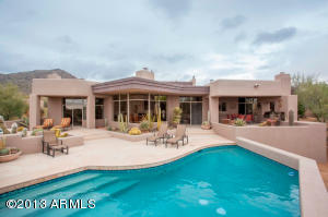 This is an absolute entertainer's delight! A heated pool and spa, grilling area and covered sitting area.