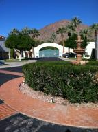 View of Entrance Gate, community fountain, and Camelback Mountain from the front of the property.
