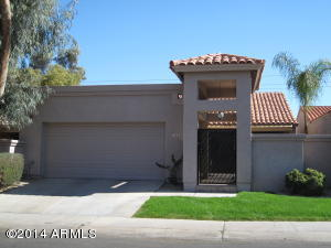 Nice Santa Fe look with stucco exterior and tile roof.