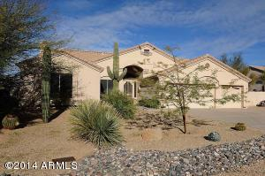 Mature easy to maintain landscaping welcomes you. Look at that large sahuaro!