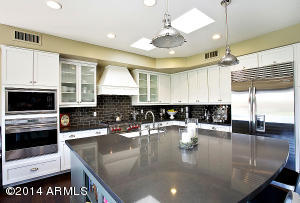 Caesarstone Island, Wolf stove, double ovens, built-in wine refrigerator.