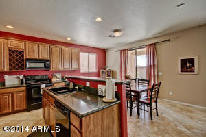 Granite Counters, Maple Cabinets and Black Appliances