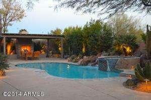 Resort style back yard with Ramada, Fireplace, Firepits, Hot Tub, Waterfalls, and Custom Lighting