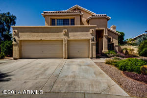 Beautiful move in ready four bedroom home in the Tempe neighborhood of Pecan Groves.