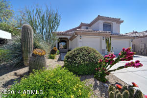 Beautiful custom desert low maintenance landscaping and great curb appeal, with freshly painted exterior of home and 3 car garage!