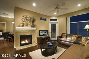 Charming living room with Quality Hardwood Floors, fireplace, and sleeper sofa.