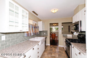 With beautiful granite counters, stainless steel appliances double sinks and backsplash.
