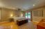 The master suite features an entrance nook, hard wood flooring, Anderson sliding door, seating area and walk-in closet.