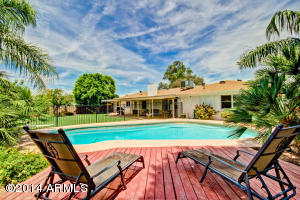 Watch your kids swim while relaxing on this nice wood deck. Or, set up your patio table and enjoy a great meal, poolside!