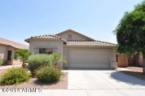 Plenty of Parking for guests and family. Fresh lovely painted exterior. All tile roof adds beauty and keeps cool in the Arizona sunshine. Lush yet low maintenance landscaping. Lovely Mature tree, natural desert beauty