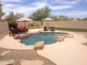 The upgraded pool with integrated boulders, cool deck, and cleaning equipment is in great shape and swim ready. Barrier fence in great shape, and is included in the sale.