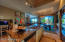 Note how open the kitchen is the dining room and greatroom. The desk is in a convenient location.