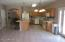 Large Tiled Kitchen With Exit to Side Patio