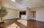 View from great room w/ beautiful engineered wood floor toward kitchen & front door.