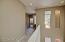 Bright, open hallway w/ skylight looking toward 2nd bedroom & bath.