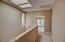 2nd floor hallway w/ skylight, looking into office w/ desert & mountain views.