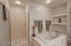 Large tub, separate shower & decorative niches in master bathroom.