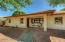 The inviting front porch with spectacular views of Camelback Mountain beckon you inside.