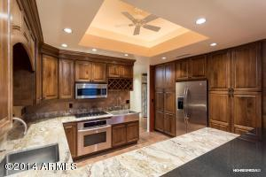 Custom Cabinetry w/Pantry Cupboards and lots of storage.