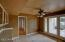 Eat In Kitchen with Buffet and Many Double Doors Leading out to Expansive Covered Patio Areas