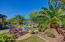 Beautifully designed back yard with large side yard and view fencing to enjoy the vegetation beyond.