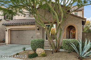 Gated entry leading to a lovely courtyard. Garage has a third tandem bay that is perfect for storage or your third car!