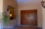 Warm and Elegant entry with gracious Cherry wood double doors leading into 22 foot high foyer.