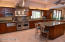 This kitchen is wide and open as it looks! It is just beautiful!