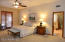 Spacious Master bedroom with french door access to heated spa, gracious sitting area, and fire place.