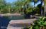 Beautifully, thoughtfully landscaped yard with abundance of fruit trees.