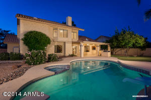 Located on a lot with north/south exposure, you'll love the feel of the back yard. You'll also LOVE the DIVING POOL w/water slide!