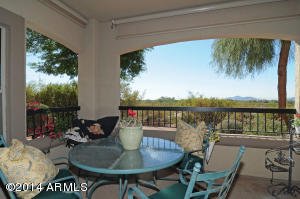 Generous, private patio provides views of mountains and open space.