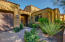 Gated courtyard entry.
