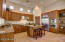 Stainless appliances, center island, granite counters and a walk-in pantry.