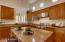 Windows above cabinets allow for more natural light.