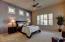 Spacious Master Bedroom with back yard views.