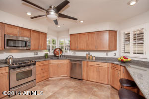 Windows and light fill this spacious, remodeled kitchen. Room to add a roller island, if desired.