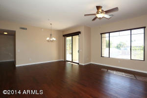 Gorgeous Update, Lovely view of lush landscape as you walk from the foyer into the Great Room.