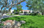 Beautifully landscaped front with circular drive