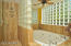 Separate jetted tub and shower